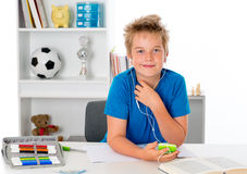 Boy is doing homework and listening music Stock Photos