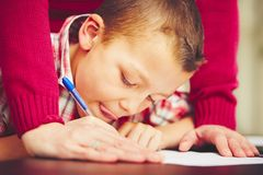 Boy is doing homework Royalty Free Stock Image