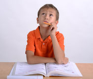 Boy doing homework. And looking up at the ceiling Stock Photos