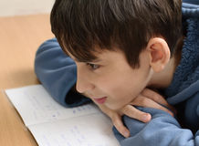 Boy does his homework Royalty Free Stock Photos