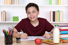Boy doing homework at school Stock Image