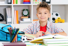Boy doing homework Stock Photos