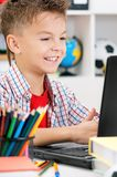Boy doing homework Stock Image