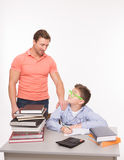 Boy doing homework at the table Stock Images