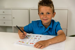 Boy doing homework Royalty Free Stock Image