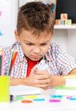 Boy doing homework Stock Photo
