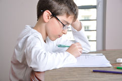 Boy doing homework Royalty Free Stock Photos