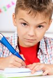 Boy doing homework Royalty Free Stock Photo