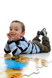 Boy doing a jigsaw on the white background royalty free stock images