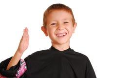 Boy doing karate chop Stock Photos