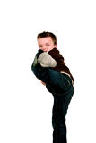 Boy doing karate kick Stock Image