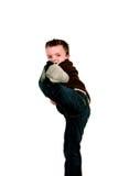 Boy doing karate kick Stock Image