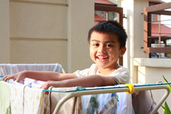Boy Doing Laundry. A boy doing his own laundry early in the morning Royalty Free Stock Photography
