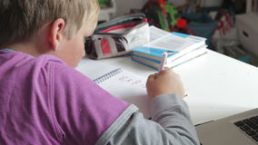 Boy Doing Math's Homework In Bedroom stock video