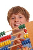 Boy doing maths. Back to school - teenage boy counting on abacus Stock Photos
