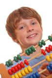Boy doing maths. Back to school - teenage boy counting on abacus Royalty Free Stock Photos