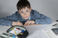 Boy doing maths homework Royalty Free Stock Images
