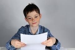 Boy  doing maths homework. Boy finished  his maths school  homework Stock Image