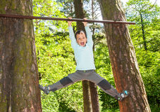 Boy doing pull ups outdoors Stock Photography