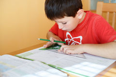 Boy doing school homework Royalty Free Stock Photos
