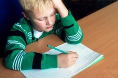 Boy doing school homework Stock Photos