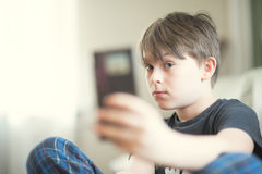 A boy doing selfie. With his smartphone Royalty Free Stock Images
