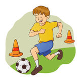 Boy Doing Soccer Practice Stock Photography