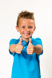 Boy doing thumbs up royalty free stock image
