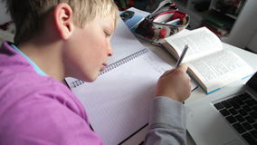 Boy Doing Written Homework In Bedroom stock footage
