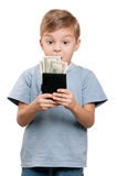 Boy with dollars. Portrait of a surprised little boy holding a dollars over white background stock image