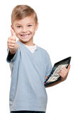 Boy with dollars. Portrait of a happy little boy with a calculator and dollars over white background Royalty Free Stock Image