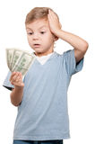 Boy with dollars. Portrait of a surprised little boy holding a dollars over white background stock images