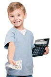 Boy with dollars. Portrait of a happy little boy with a calculator and dollars over white background Royalty Free Stock Photography