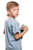 Boy with dollars. Portrait of a little boy holding a dollars over white background stock photography