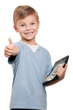 Boy with dollars. Portrait of a happy little boy with a calculator and dollars over white background stock photography
