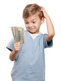 Boy with dollars. Portrait of a surprised little boy holding a dollars over white background Royalty Free Stock Images