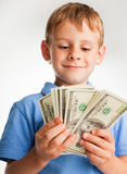 Boy with dollars Stock Photo