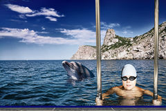 Boy and dolphin Royalty Free Stock Photography
