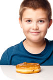 Boy and a donut Royalty Free Stock Photos
