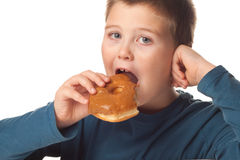 Boy and a donut Royalty Free Stock Image