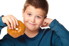 Boy and a donut Stock Photos