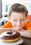 Boy with donut Royalty Free Stock Photo