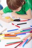 Boy doodling on white paper. Image of boy doodling, on white background Stock Images
