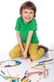 Boy doodling on white paper. Image of boy doodling, on white background Stock Photos
