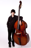 Boy with double bass. Young boy with large double bass; isolated on white background Stock Images