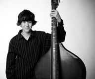 Boy with double bass Royalty Free Stock Photo
