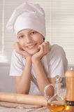 Boy with dough prepares cookies Royalty Free Stock Image