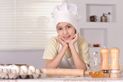 Boy with dough prepares cookies Stock Image