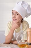 Boy with dough prepares  cookies Royalty Free Stock Photo