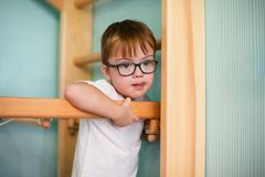 Boy with down syndrome. At home stock image